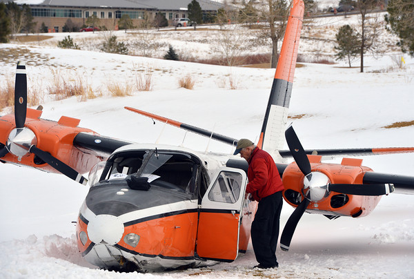 bent0303aircrash13.JPG A man identified as the pilot of a Twin Aero Commander looks over the plane after he crash landed on the Omni Interlocken Golf Course on Friday.<br /> <br /> March 1, 2013<br /> staff photo/ David R. Jennings