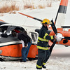 bent0303aircrash12.JPG North Metro Fire Rescue firefighter and Rocky Mountain Metropolitan Airport operations crew member investigate the crash of a Twin Aero Commander on the Omni Interlocken Golf Course on Friday.<br /> March 1, 2013<br /> staff photo/ David R. Jennings
