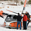 bent0303aircrash11.JPG Rocky Mountain Metro Airport operations crew member, left, interveiws the pilot and passenger of the Twin Aero Commander Airplane that crash landed on the Omni Interlocken Golf Course on Friday.<br /> March 1 2013<br /> staff photo/ David R. Jennings