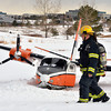 bent0303aircrash09.JPG North Metro Fire Rescue firefighters walk past a Twin Aero Commander that crashed in the Omni Interlocken Golf Course on Friday.<br /> March 1, 2013<br /> staff photo/ David R. Jennings