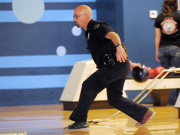 Broomfeild Police officer Dominic Gardano delivers the ball  during the Police vs. Fire Bowling Tournament for A Precious Child at Chippers Lanes Bowling Alley on Sunday.<br /> April 10, 2011<br /> staff photo/David R. Jennings