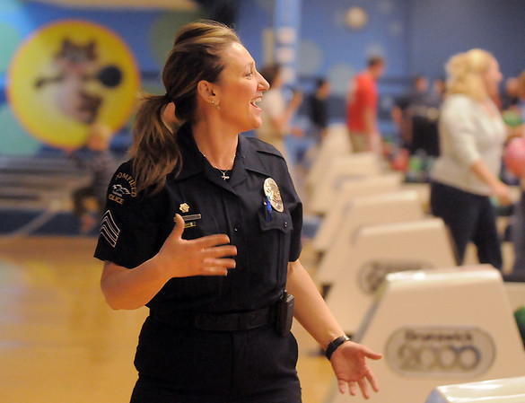 Broomfield Police officer Enea Hempelmann reacts after bowling a frame  during the Police vs. Fire Bowling Tournament for A Precious Child at Chippers Lanes Bowling Alley on Sunday.<br /> April 10, 2011<br /> staff photo/David R. Jennings