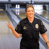 Broomfield Police officer Enea Hempelmann clicks her fingers after missing two pins during the Police vs. Fire Bowling Tournament for A Precious Child at Chippers Lanes Bowling Alley on Sunday.<br /> April 10, 2011<br /> staff photo/David R. Jennings