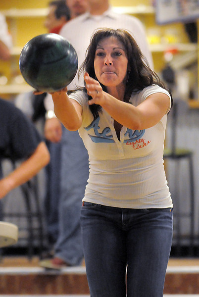 Broomfield Police officer Angelia Scanga delivers the ball during the Police vs. Fire Bowling Tournament for A Precious Child at Chippers Lanes Bowling Alley on Sunday.<br /> April 10, 2011<br /> staff photo/David R. Jennings