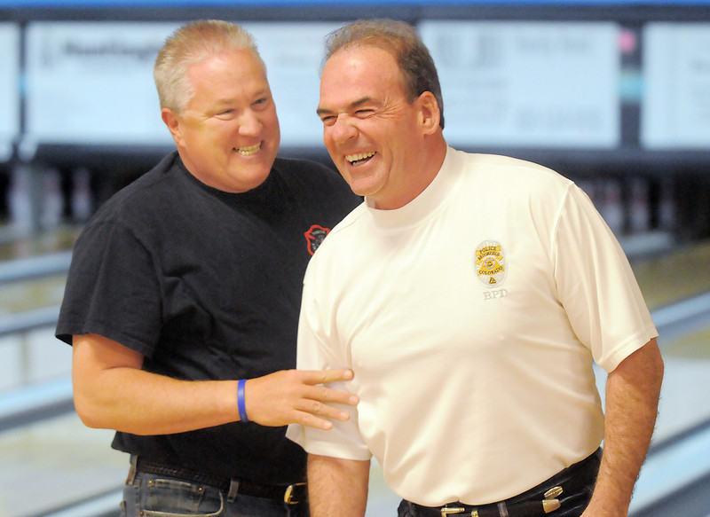 North Metro Fire Rescue Chief Joe Bruce, left, laughs with Broomfield Police Chief Tom Deland at the Police vs. Fire Bowling Tournament for A Precious Child at Chippers Lanes Bowling Alley on Sunday.<br /> April 10, 2011<br /> staff photo/David R. Jennings