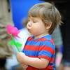Aaron Lazio, 2, tries blowing a pinwheel during the Preschool Easter Party at the Broomfield Community Center on Thursday.<br /> April 5, 2012 <br /> staff photo/ David R. Jennings