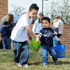 Jaxxon Martinez, 5, left, and his brother, Tysson, 2, look for plastic Easter eggs during the Preschool Easter Party at the Broomfield Community Center on Thursday.<br /> April 5, 2012 <br /> staff photo/ David R. Jennings