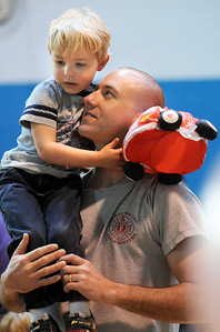 Owen Hayden, 3, sits on the shoulders of his father Travis during the Preschool  Easter Party at the Broomfield Community Center on Thursday. April 1, 2010 Staff photo/David R. Jennings