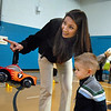Nicole Kerr points out Flopsy the Bunny to her son Brody, 2,  during the Preschool Easter Party at the Broomfield Community Center on Thursday.<br /> April 1, 2010<br /> Staff photo/David R. Jennings