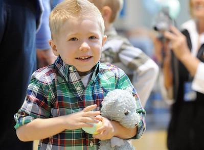Logan Wiegert, 3, holding his blue rabbit, waits to see Flopsy the Bunny during the Preschool Easter Party at the Broomfield Community Center on Thursday.  April 1, 2010 Staff photo/David R. Jennings