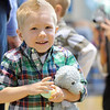 Logan Wiegert, 3, holding his blue rabbit, waits to see Flopsy the Bunny during the Preschool Easter Party at the Broomfield Community Center on Thursday.<br /> <br /> April 1, 2010<br /> Staff photo/David R. Jennings