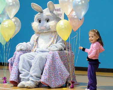 Sadea Insley, 3, shows her parents Flopsy the Bunny during the Preschool Easter Party at the Broomfield Community Center on Thursday. April 1, 2010 Staff photo/David R. Jennings