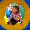 Sadea Insley, 3, works her way through the inflatable mase during the Preschool Easter Party at the Broomfield Community Center on Thursday.<br /> April 1, 2010<br /> Staff photo/David R. Jennings