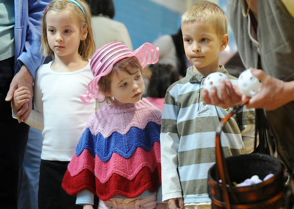 Chole Rupsa, 3 1/2, center, waits with her cousins Lauren and Ryan Bragg, 4, to toss plastic balls in to baskets for a prize during the Preschool Easter Party at the Broomfield Community Center on Thursday.<br /> April 1, 2010<br /> Staff photo/David R. Jennings
