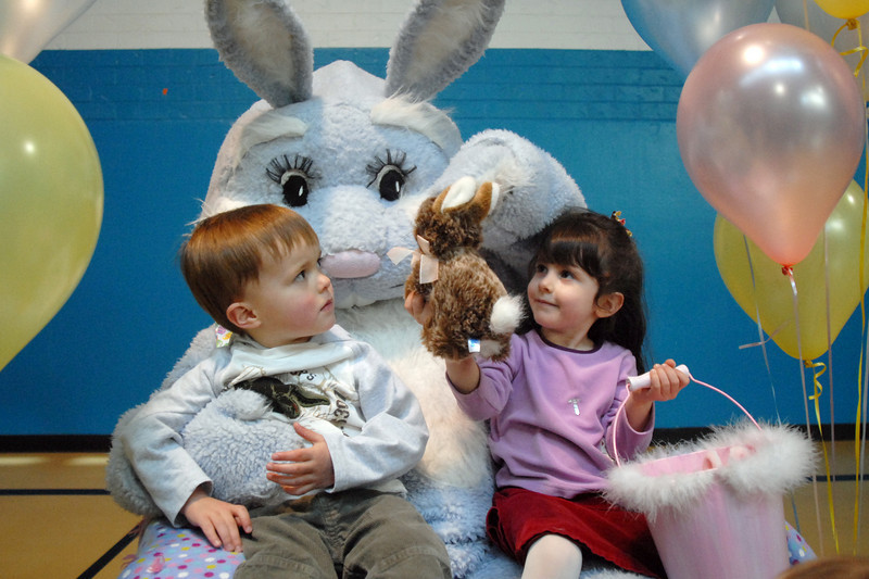 Taylor Portillo, 3 1/2, right, shows Flopsy the Bunny a toy bunny while her cousin Carson Richards, 3, watches during the Preschool Easter Party at the Broomfield Community Center on Thursday. 110 preschoolers attended the morning Easter Party.<br /> April 1, 2010<br /> Staff photo/David R. Jennings