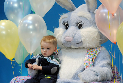 Brody Kerr, 2, sits on Flopsy the Bunny's lap for pictures during the Preschool Easter Party at the Broomfield Community Center on Thursday. April 1, 2010 Staff photo/David R. Jennings