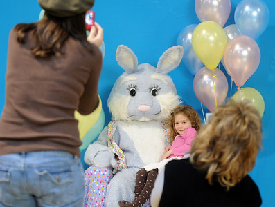 Corinne Clark, 4, sits on Flopsy the Bunny's lap while her picture is taken during the Preschool Easter Party at the Broomfield Community Center on Thursday. April 1, 2010 Staff photo/David R. Jennings