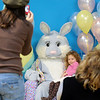 Corinne Clark, 4, sits on Flopsy the Bunny's lap while her picture is taken during the Preschool Easter Party at the Broomfield Community Center on Thursday.<br /> April 1, 2010<br /> Staff photo/David R. Jennings