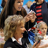 Nicole Kerr, top and Barbara Ploeger take pictures of Kerr's son Brody, 2 during the Preschool Easter Party at the Broomfield Community Center on Thursday.<br /> April 1, 2010<br /> Staff photo/David R. Jennings
