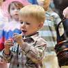 Conor Noulin, 2 1/2, looks at his prize for playing a game during the Preschool Easter Party at the Broomfield Community Center on Thursday.<br /> April 1, 2010<br /> Staff photo/David R. Jennings
