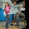 Keeley Williams, 3, pulls her mother Tammy to see Flopsy the Bunny during the Preschool Easter Party at the Broomfield Community Center on Thursday.<br /> April 1, 2010<br /> Staff photo/David R. Jennings