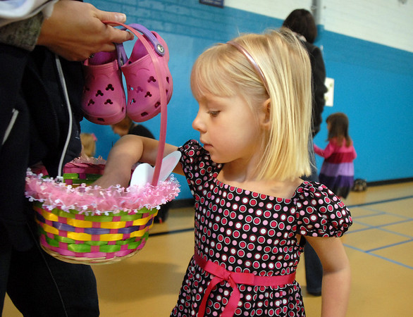 Kadence Hesse, 3, looks in her Easter Basket during the Preschool <br /> Easter Party at the Broomfield Community Center on Thursday.<br /> April 1, 2010<br /> Staff photo/David R. Jennings