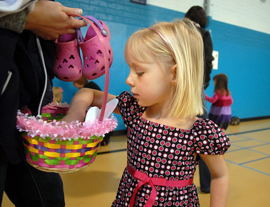 Kadence Hesse, 3, looks in her Easter Basket during the Preschool  Easter Party at the Broomfield Community Center on Thursday. April 1, 2010 Staff photo/David R. Jennings