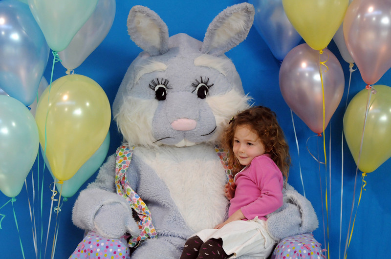 Corinne Clark, 4,  sits on Flopsy the Bunny's lap for pictures during the Preschool Easter Party at the Broomfield Community Center on Thursday.<br /> April 1, 2010<br /> Staff photo/David R. Jennings