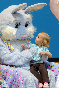 Tess Jaramillo, 2, looks at Flopsy the Bunny while sitting on his lap  during the Preschool Easter Party at the Broomfield Community Center on Thursday. April 1, 2010 Staff photo/David R. Jennings