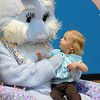 Tess Jaramillo, 2, looks at Flopsy the Bunny while sitting on his lap  during the Preschool Easter Party at the Broomfield Community Center on Thursday.<br /> April 1, 2010<br /> Staff photo/David R. Jennings