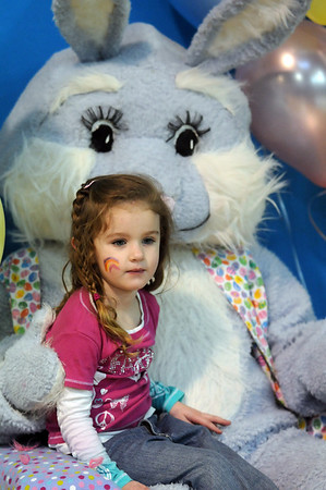 Keeley Williams, 3, poses for pictures with Flopsy the Bunny during the Preschool Easter Party at the Broomfield Community Center on Thursday.<br /> April 1, 2010<br /> Staff photo/David R. Jennings
