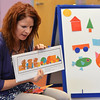 Children's librarian Susan Person read the book Mouse Shapes during the preschool story time at the Mamie Doud Eisenhower Public Library on Thursday.<br /> December 27, 2012<br /> staff photo/ David R. Jennings