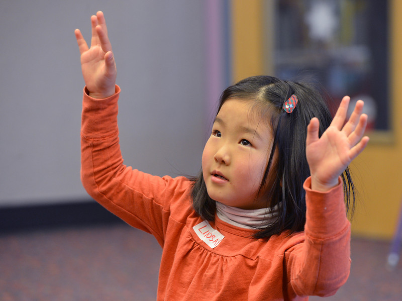 """Lindsay Uba, 5, gestures while the book """"Find a Cow NOW!""""  is read by children's librarian Susan Person during the preschool story time at the Mamie Doud Eisenhower Public Library on Thursday.<br /> December 27, 2012<br /> staff photo/ David R. Jennings"""