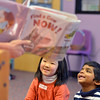 "Lindsay Uba, 5, left, and Pavan Gunasinghe, 4, look at the pictures in the book ""Find a Cow NOW!""  read by children's librarian Susan Person during the preschool story time at the Mamie Doud Eisenhower Public Library on Thursday.<br /> December 27, 2012<br /> staff photo/ David R. Jennings"