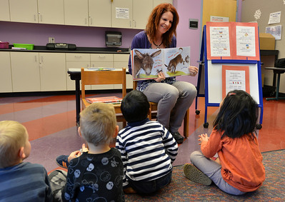 """Children's librarian Susan Person reads the book """"Find a Cow NOW!""""  read by children's librarian Susan Person during the preschool story time at the Mamie Doud Eisenhower Public Library on Thursday. December 27, 2012 staff photo/ David R. Jennings"""