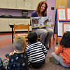 "Children's librarian Susan Person reads the book ""Find a Cow NOW!""  read by children's librarian Susan Person during the preschool story time at the Mamie Doud Eisenhower Public Library on Thursday.<br /> December 27, 2012<br /> staff photo/ David R. Jennings"