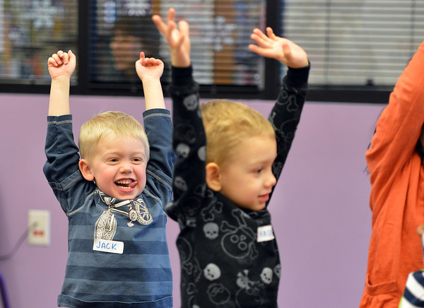 Jack Smith, 4, left, and Mason Monroe, 4, stretch during a break of children's librarian Susan Person reading books during the preschool story time at the Mamie Doud Eisenhower Public Library on Thursday.<br /> December 27, 2012<br /> staff photo/ David R. Jennings
