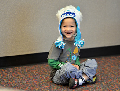 Ian Dolber, 4,  smiles while listening to children's librarian Susan Person read a book during the preschool story time at the Mamie Doud Eisenhower Public Library on Thursday. December 27, 2012 staff photo/ David R. Jennings