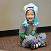 Ian Dolber, 4,  smiles while listening to children's librarian Susan Person read a book during the preschool story time at the Mamie Doud Eisenhower Public Library on Thursday.<br /> December 27, 2012<br /> staff photo/ David R. Jennings