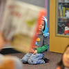 Ian Dolber, 4, watches and listens at a distance to children's librarian Susan Person read a book during the preschool story time at the Mamie Doud Eisenhower Public Library on Thursday.<br /> December 27, 2012<br /> staff photo/ David R. Jennings