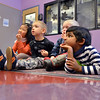 Lindsay Uba, 5, left, Mason Monroe, 4, Jack Smith, 4, and Pavan Gunasinghe, 4,  listen to children's librarian Susan Person read a book during the preschool story time at the Mamie Doud Eisenhower Public Library on Thursday.<br /> December 27, 2012<br /> staff photo/ David R. Jennings