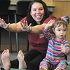 Melanie Adkins and her daughter Madeline, 2 1/2, perform yoga exercises during the Preschool Yoga/Movement session taught by Sara Guenther at the Mamie Doud Eisenhower Public Library on Saturday.<br /> <br /> November 18, 2011<br /> staff photo/ David R. Jennings