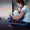 Carol Farrell and her grand daughter Kayla Bree Farrell-Herick, 2, perform a calming yoga exercise during the Preschool Yoga/Movement session taught by Sara Guenther at the Mamie Doud Eisenhower Public Library on Saturday.<br /> <br /> <br /> November 18, 2011<br /> staff photo/ David R. Jennings