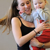 Katie Burke and her daughter Miranda, 18 months-old, move around the room for the Preschool Yoga/Movement session taught by Sara Guenther at the Mamie Doud Eisenhower Public Library on Saturday.<br /> <br /> November 18, 2011<br /> staff photo/ David R. Jennings