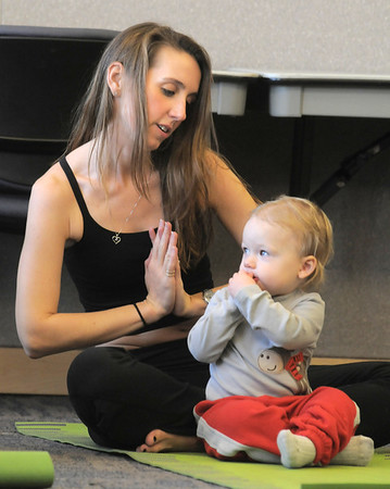 Katie Burke and her daughter Miranda, 18 months-old, perform yoga moves during the Preschool Yoga/Movement session taught by Sara Guenther at the Mamie Doud Eisenhower Public Library on Saturday.<br /> <br /> November 18, 2011<br /> staff photo/ David R. Jennings