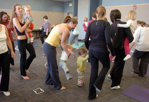 The Preschool Yoga/Movement class moves around the room  at the Mamie Doud Eisenhower Public Library on Saturday.<br /> <br /> November 18, 2011<br /> staff photo/ David R. Jennings