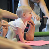 Avery Ditsworth, 15 months-old, performs yoga exercises with her mother Jackie Bradley during the Preschool Yoga/Movement session taught by Sara Guenther begins at the Mamie Doud Eisenhower Public Library on Saturday.<br /> <br /> November 18, 2011<br /> staff photo/ David R. Jennings