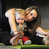 Katie Burke and her daughter Miranda, 18 months-old, do yoga moves during the Preschool Yoga/Movement session taught by Sara Guenther at the Mamie Doud Eisenhower Public Library on Saturday.<br /> November 19, 2011<br /> staff photo/ David R. Jennings