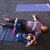 Janice Steinbach and her son Cole Mezger, 4, perform a calming yoga exercise during the Preschool Yoga/Movement session taught by Sara Guenther at the Mamie Doud Eisenhower Public Library on Saturday.<br /> November 18, 2011<br /> staff photo/ David R. Jennings