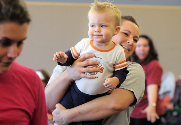 Kelleigh Betts carries her son Conor, 16 months-old, as they move around the room during the Preschool Yoga/Movement session taught by Sara Guenther at the Mamie Doud Eisenhower Public Library on Saturday.<br /> <br /> November 18, 2011<br /> staff photo/ David R. Jennings